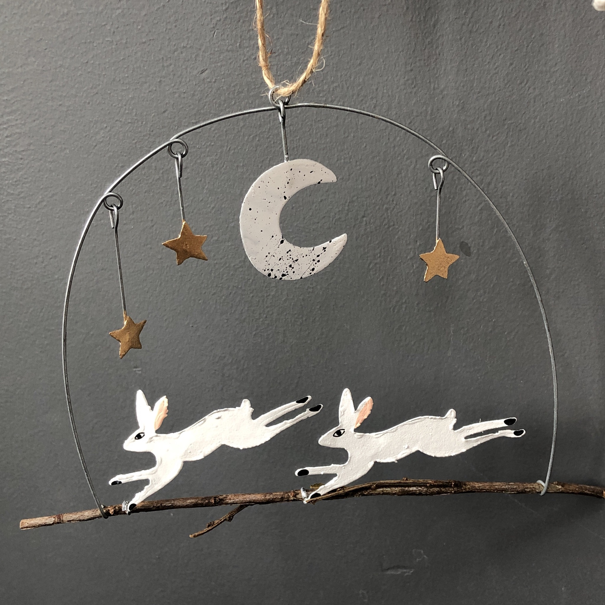 Two running hares  in the moonlight, hanging decoration by shoeless joe