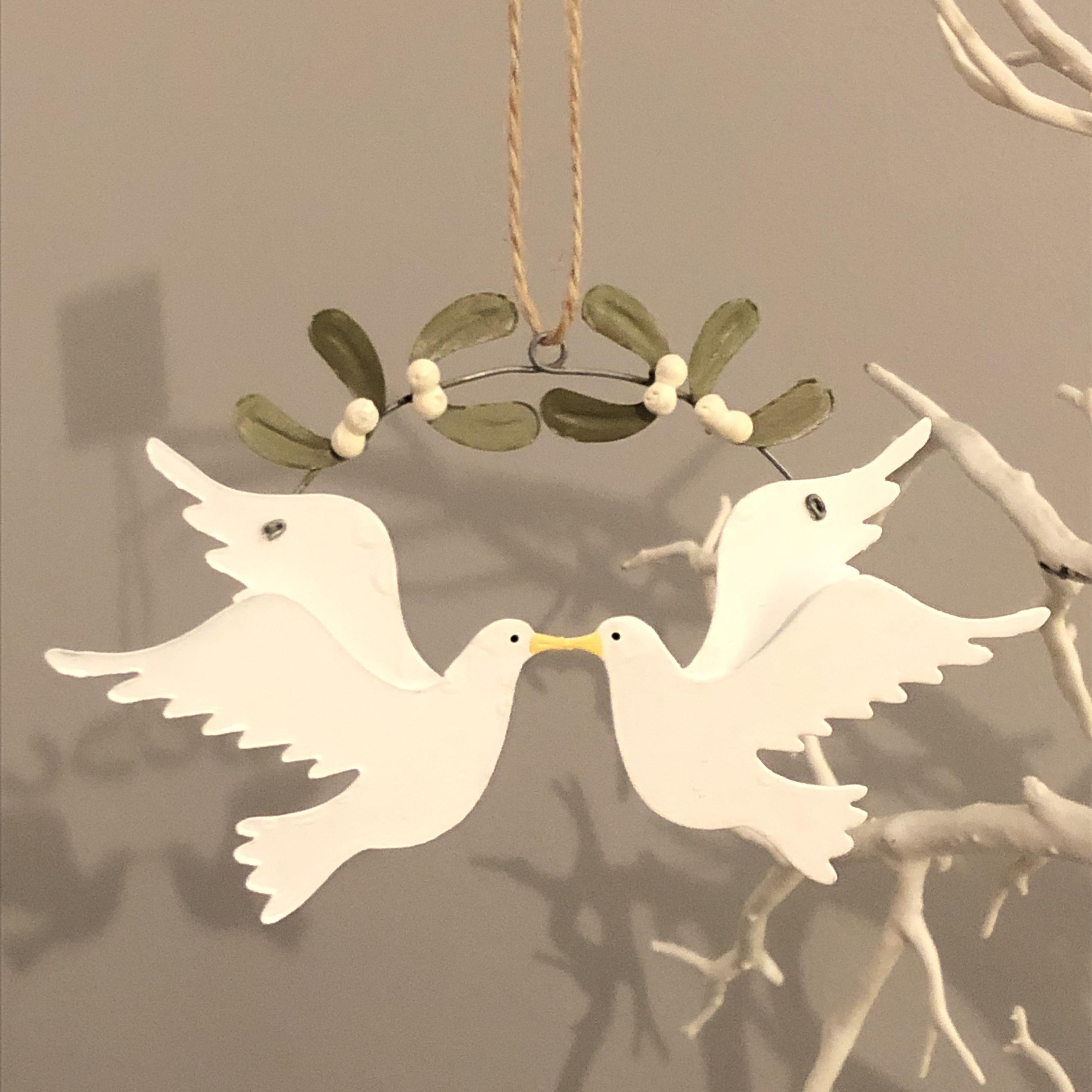 Dove couple under the mistletoe hanging decoration by shoeless joe