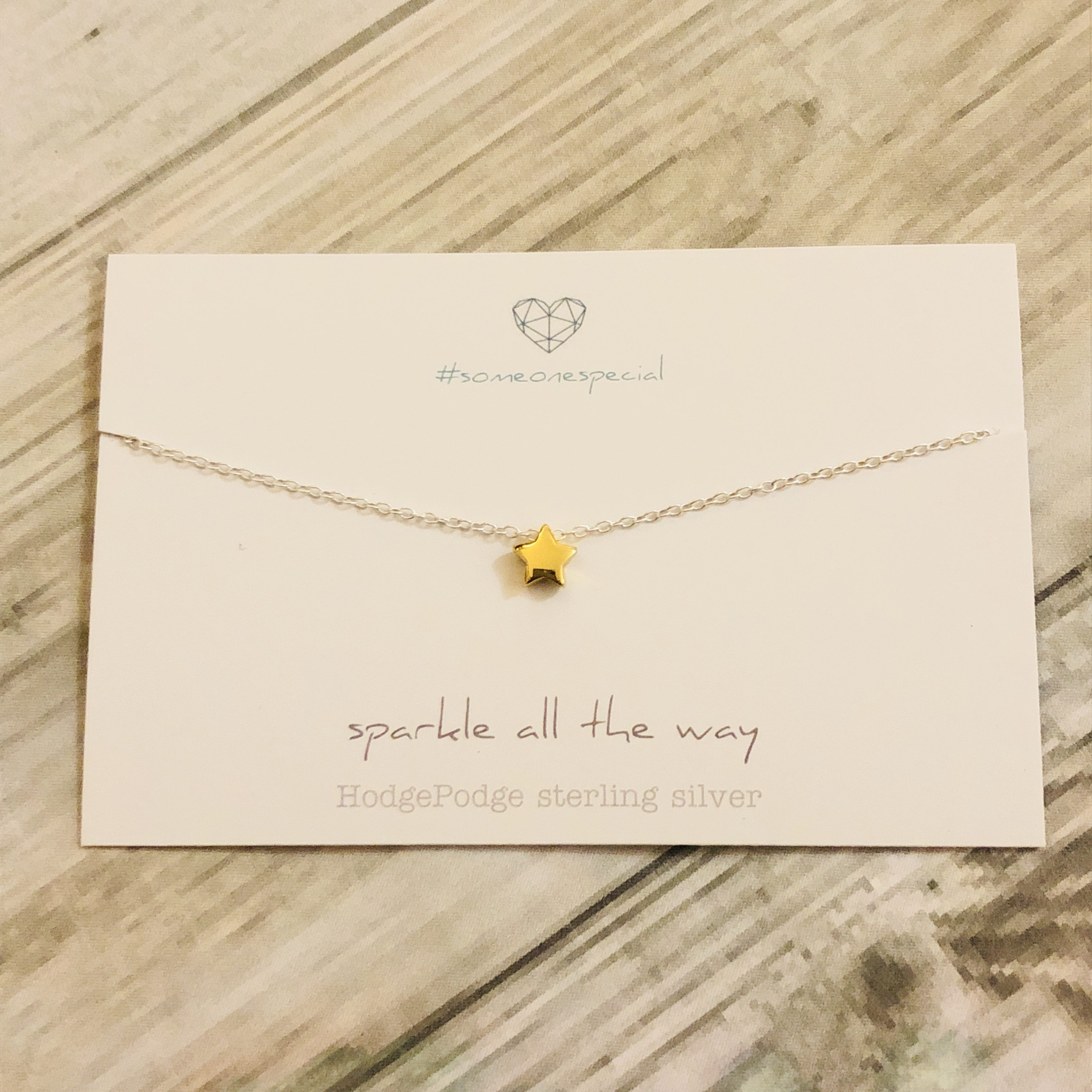 Gold star necklace- sparkle all the way.  Sterling silver necklace
