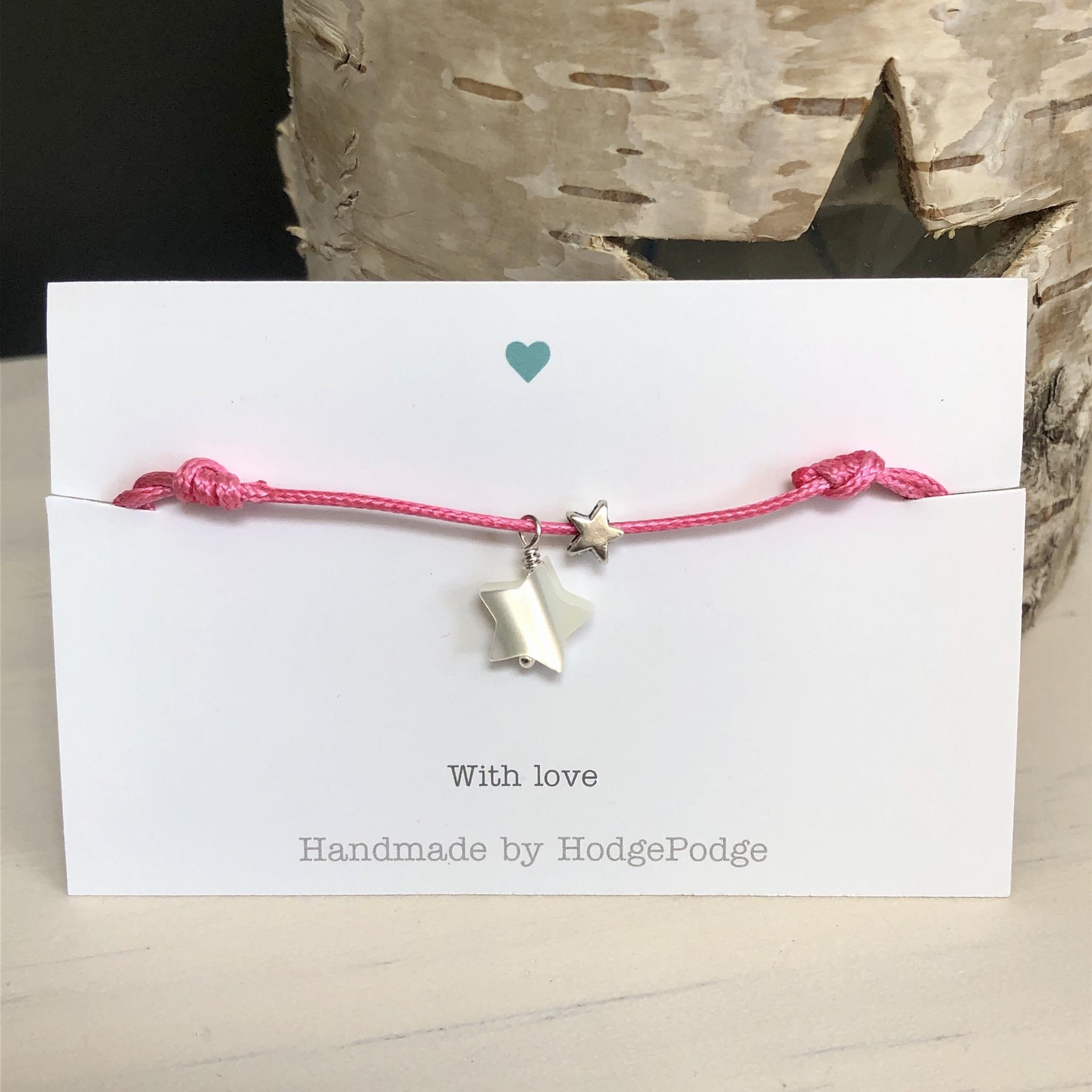 Adjustable cord bracelet with stars dark pink.