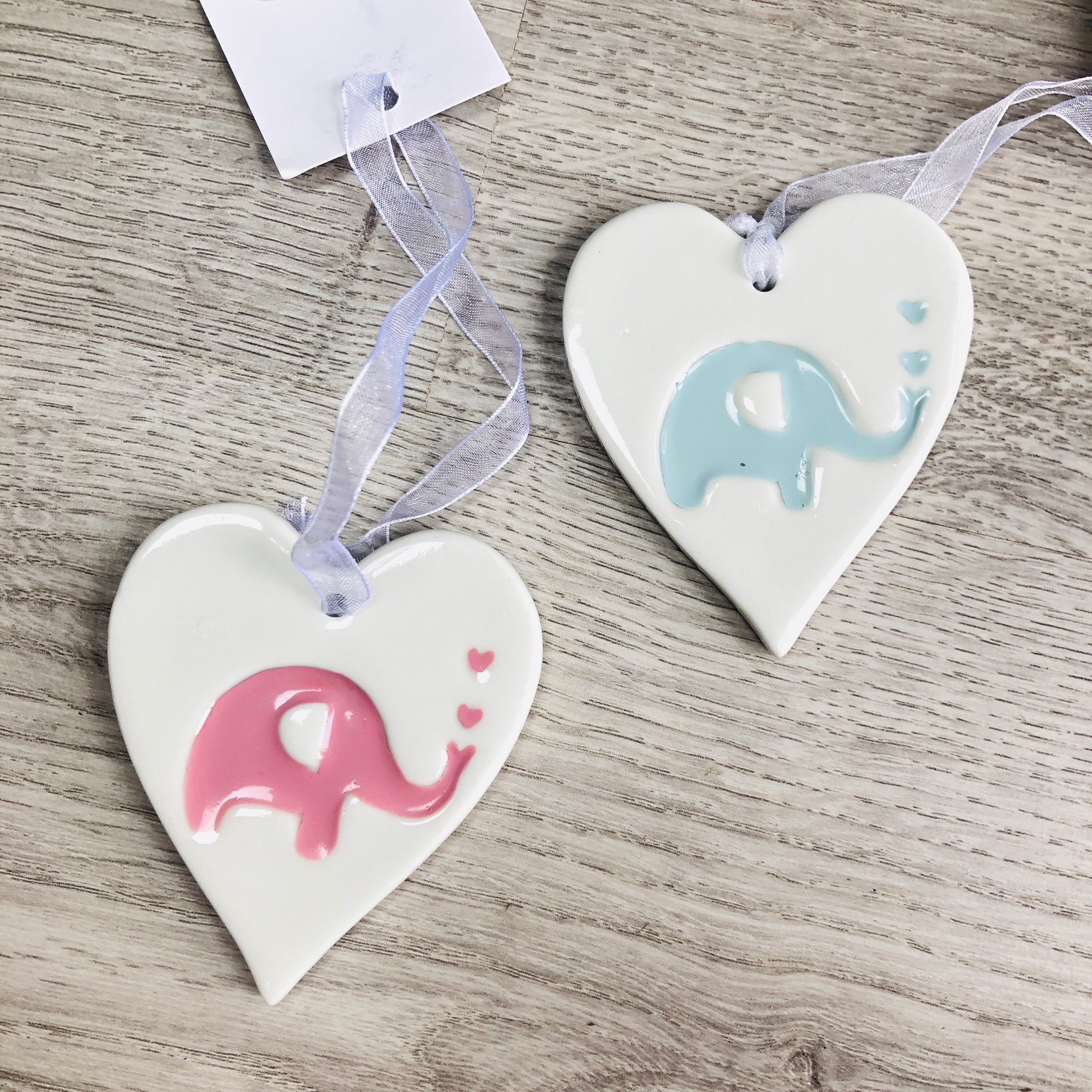 New baby hanging ceramic heart with elephant.