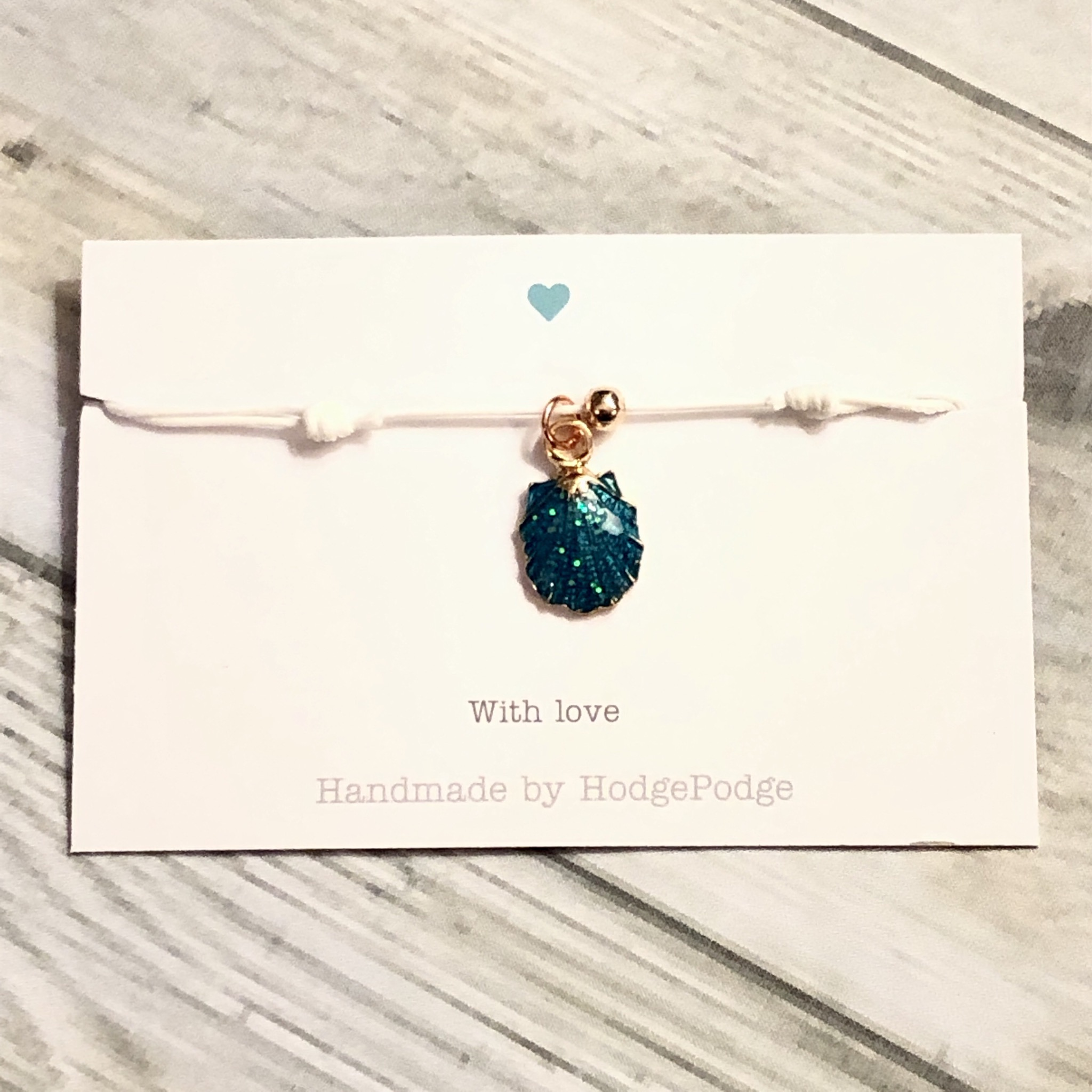 Shell charm adjustable cord bracelet. 4 colours to choose from