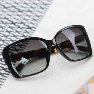 Dark brown tortoiseshell polycarbonate sunglasses by POM