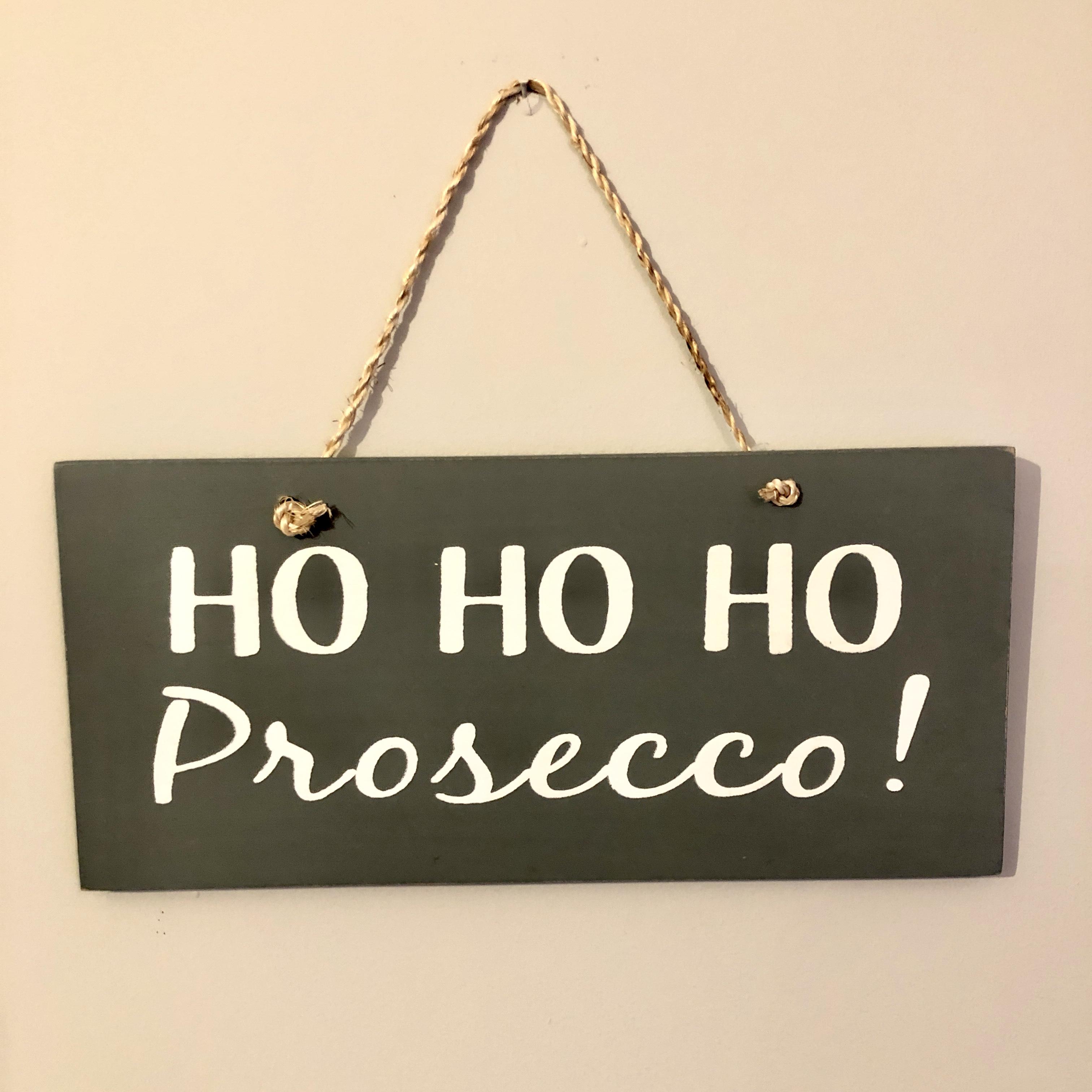 Ho ho ho Prosecco. Hanging Christmas sign by shoeless joe