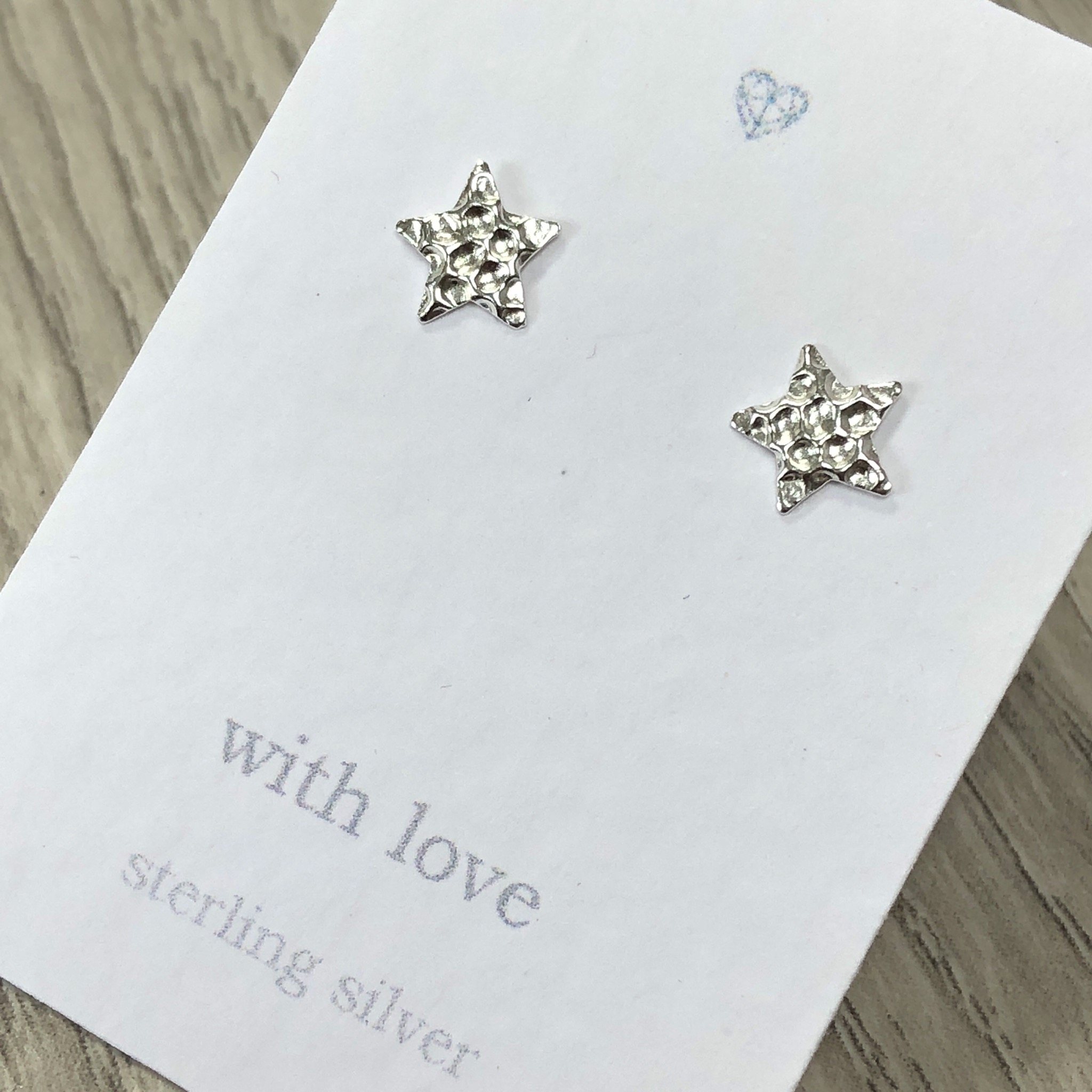 Dimpled textured star stud earrings sterling silver