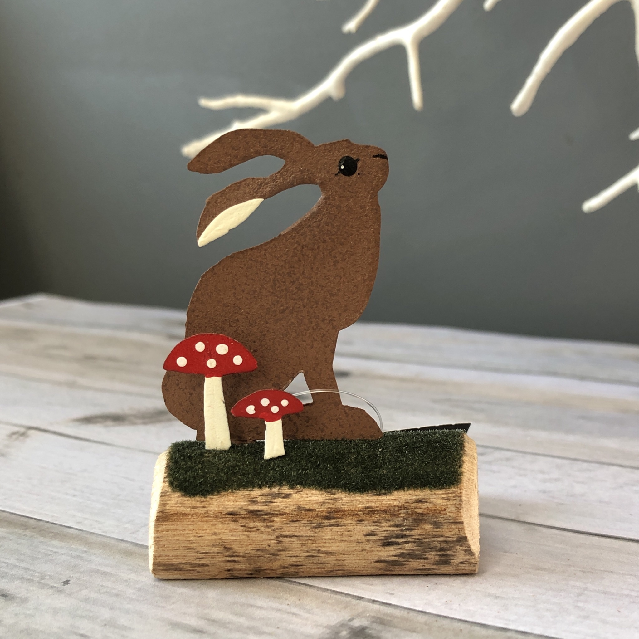 Hare sitting on log standing ornament by shoeless joe