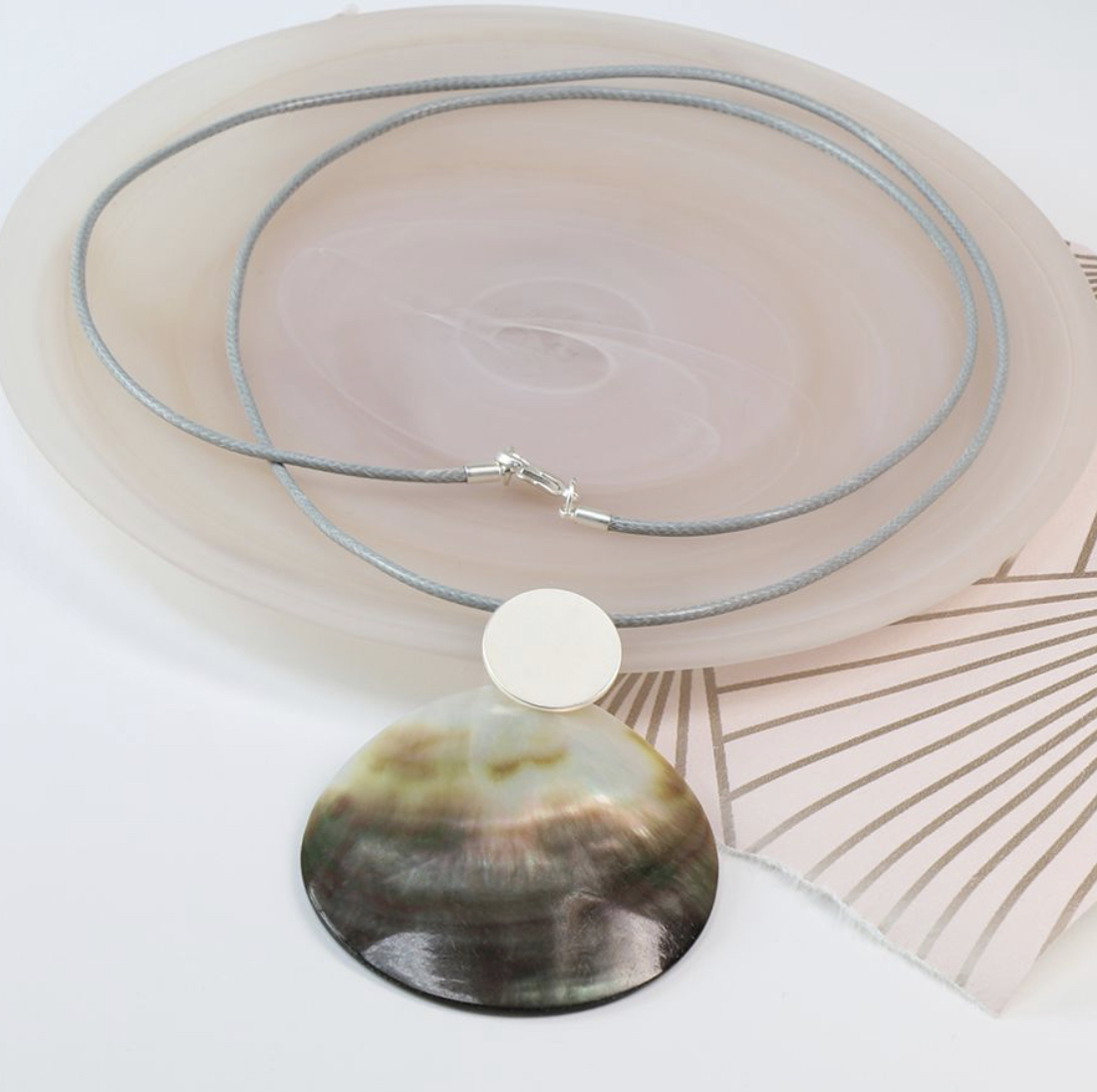 Shell and matt silver double disc long necklace By POM peace of mind