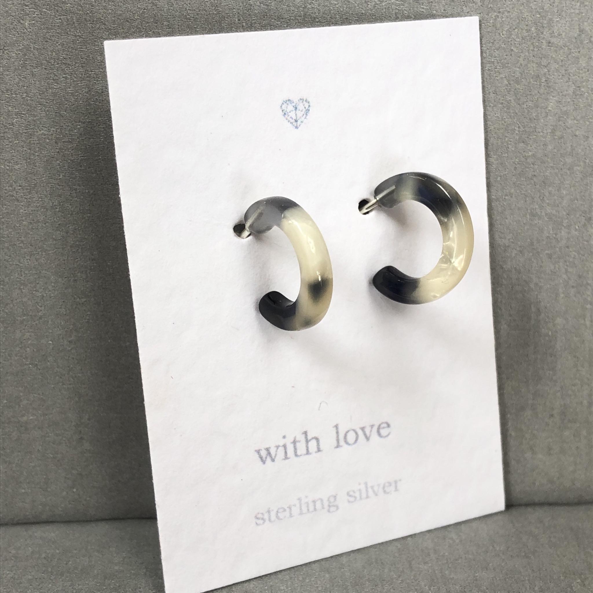 Black and white resin half hoop Sterling Silver earrings.