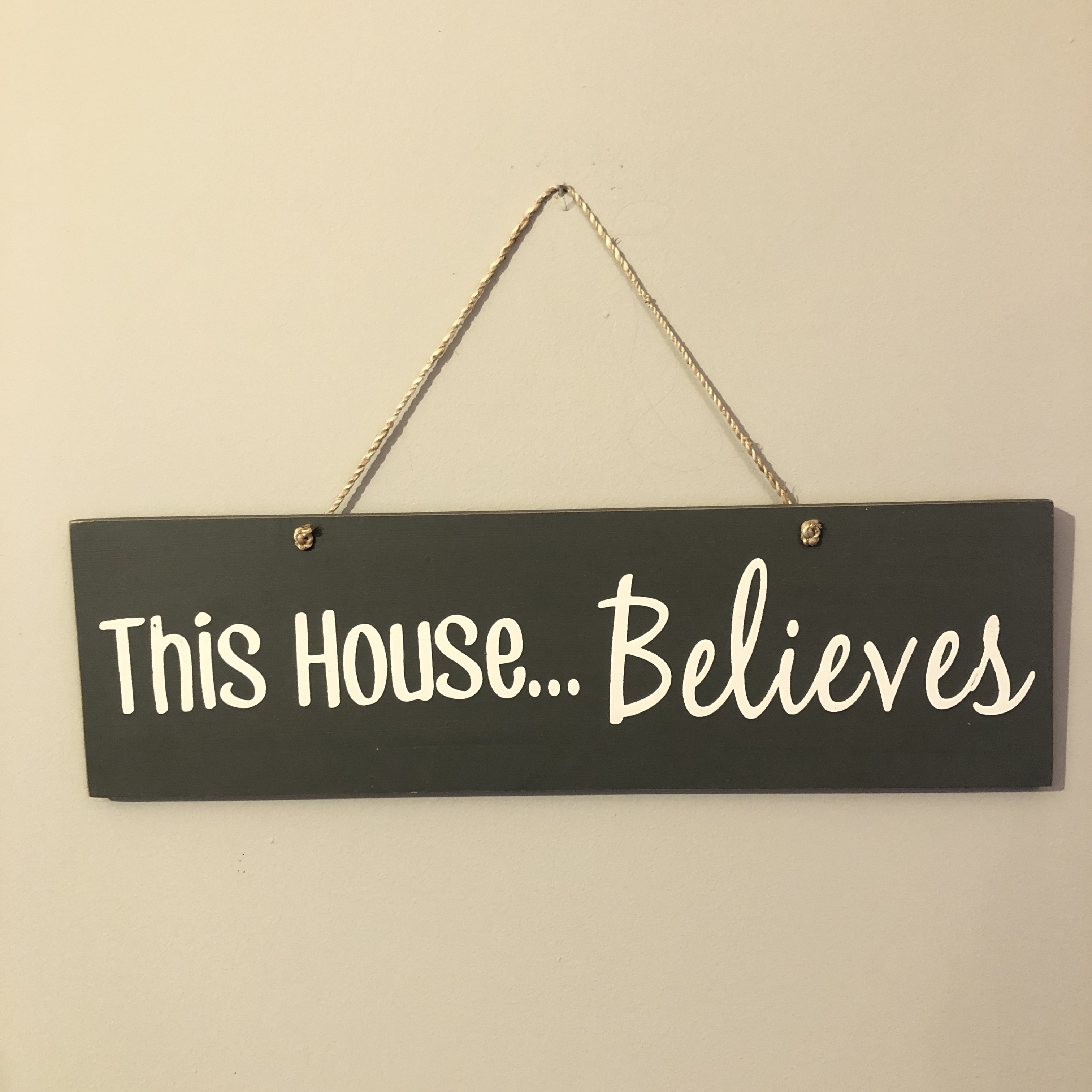 This house  believes hanging wooden Christmas sign by shoeless joe.