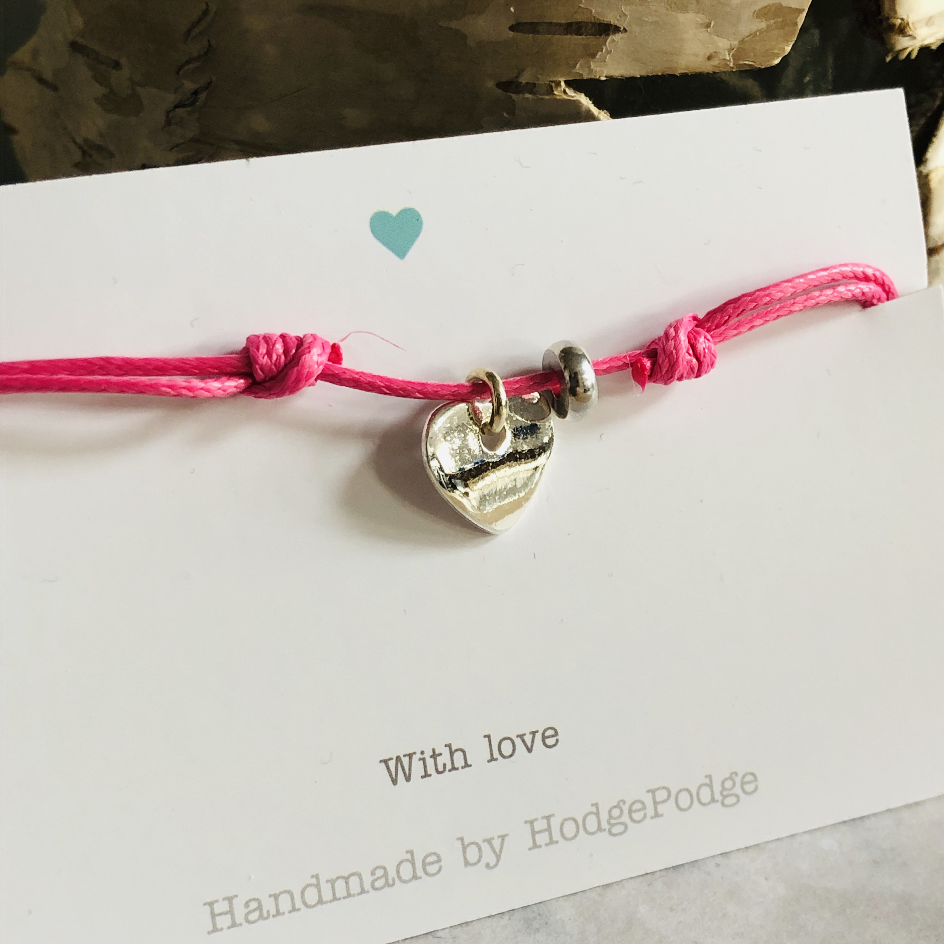 Adjustable cord bracelet with silver heart