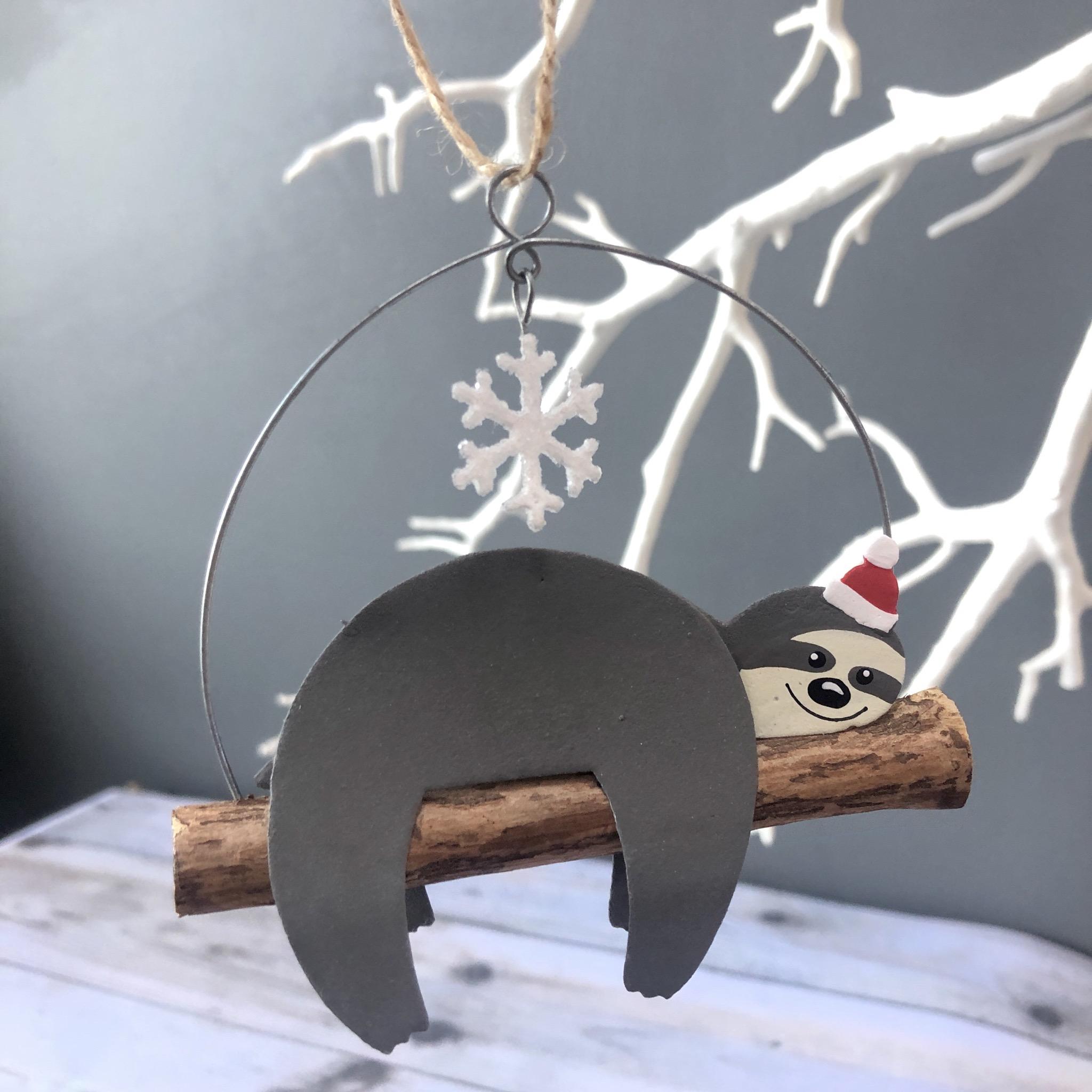 Christmas sloth  tree decorating by shoeless joe
