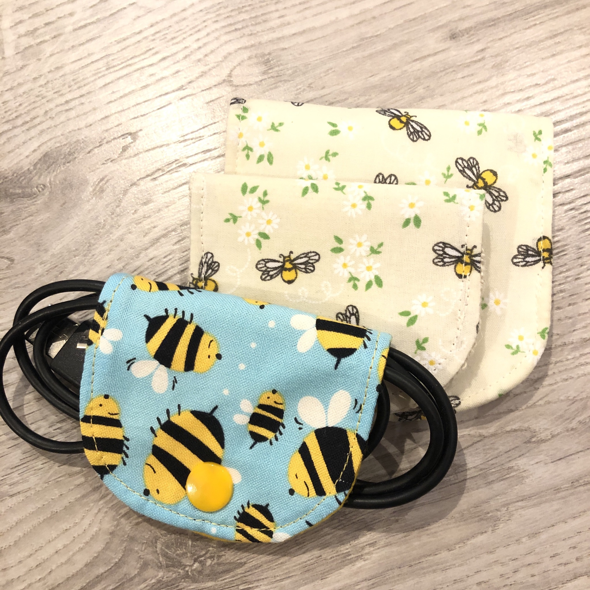Bee fabric charger cable tidies by Stella's stitchcraft.