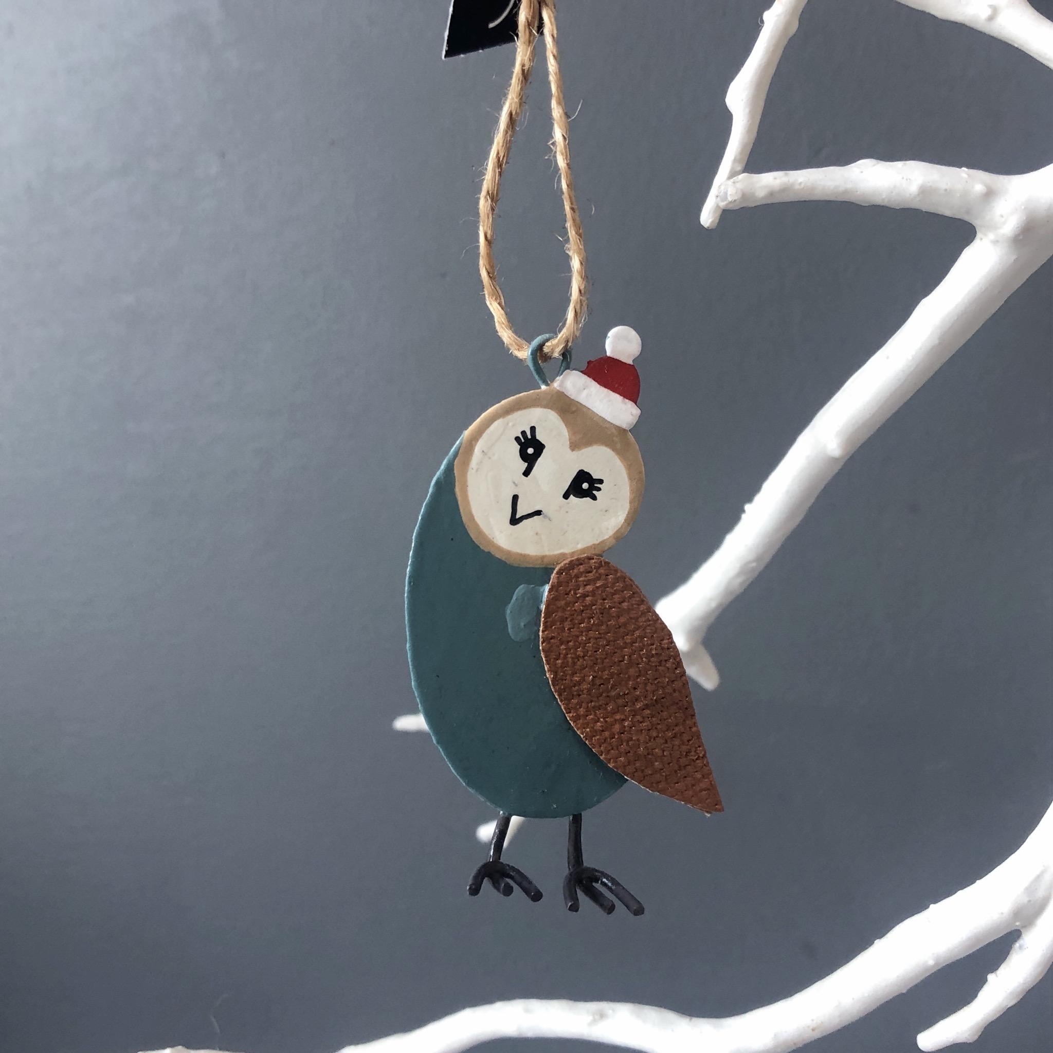 Barn owl  wearing a Christmas bobble hat. Hanging decoration by shoeless joe