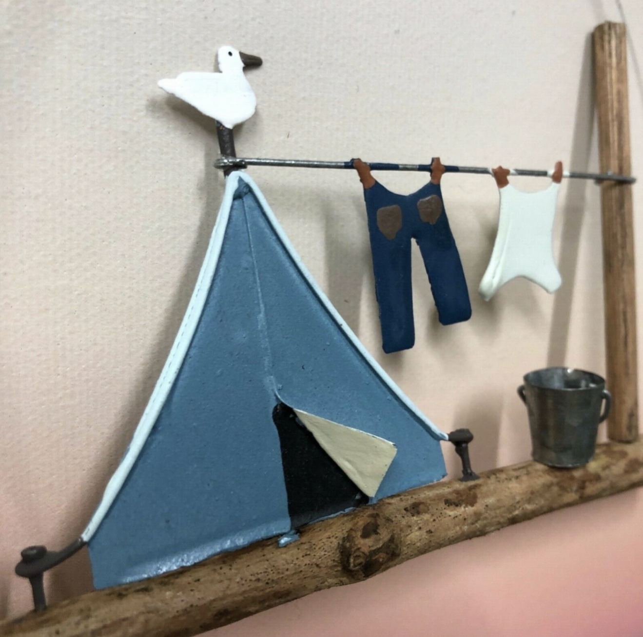 Retro blue tent with washing hanging decoration by shoeless joe