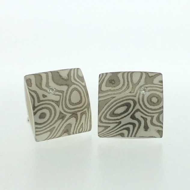 18k white gold and silver mokume gane square pillow stud earring with flush set diamonds