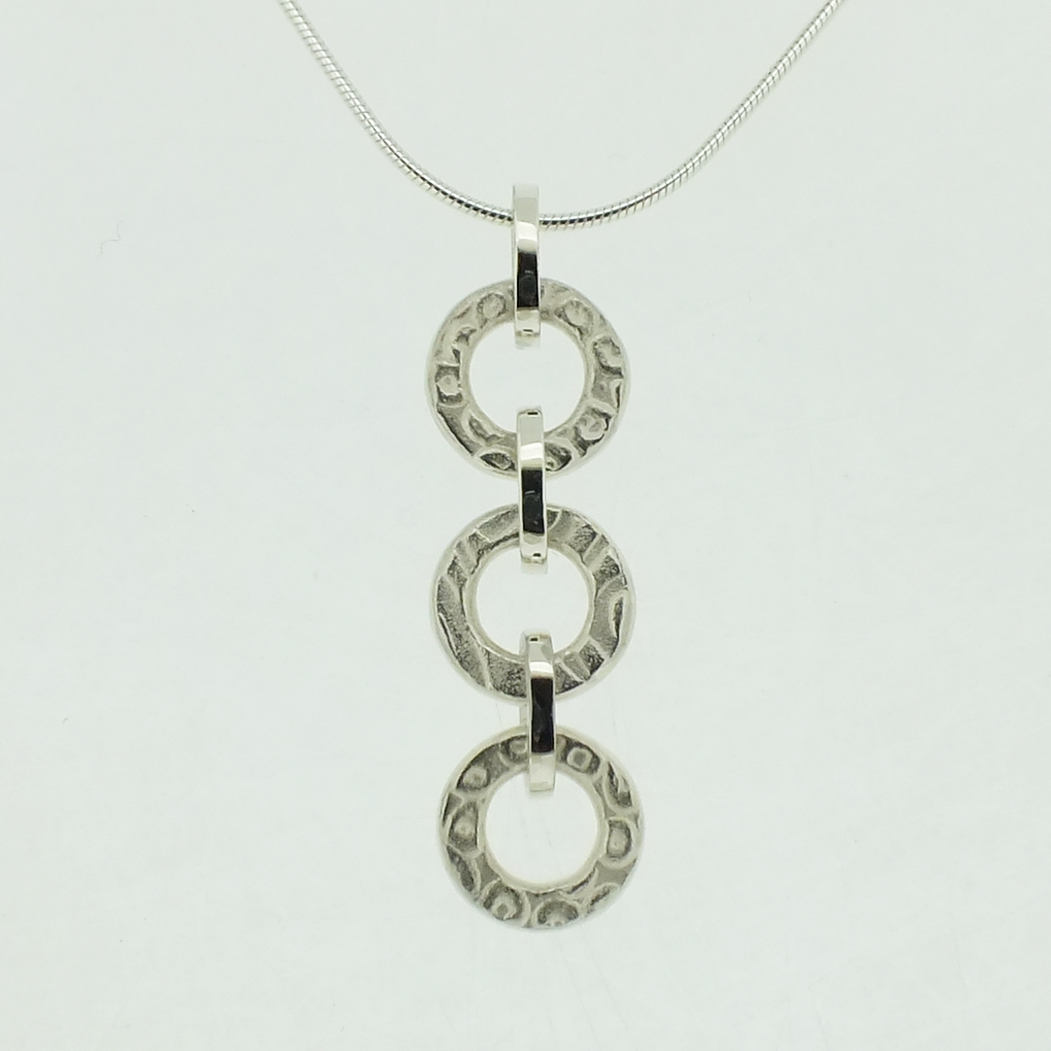 Triple Ring Pendant in textured sterling silver