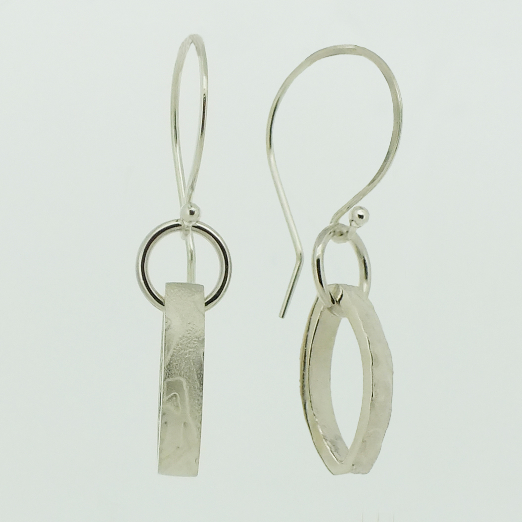 Reversible Ellipse textured silver drop earrings