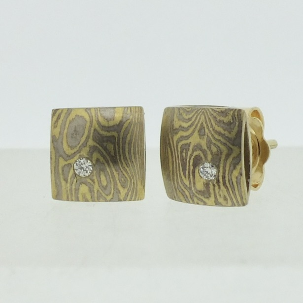 18k white and yellow gold mokume gane small pillow stud earrings with flush set diamonds