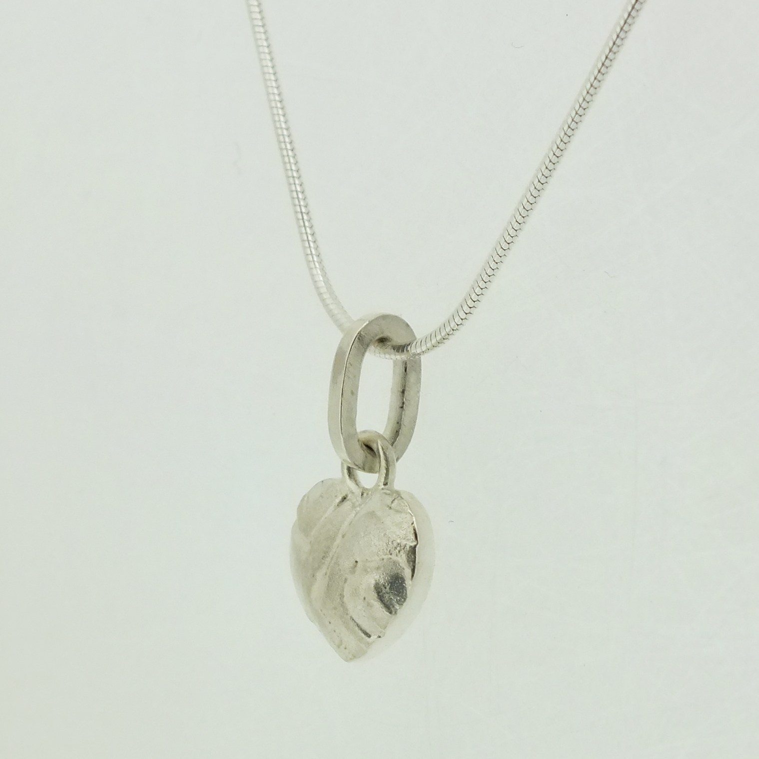 Small Heart Pendant in textured sterling silver