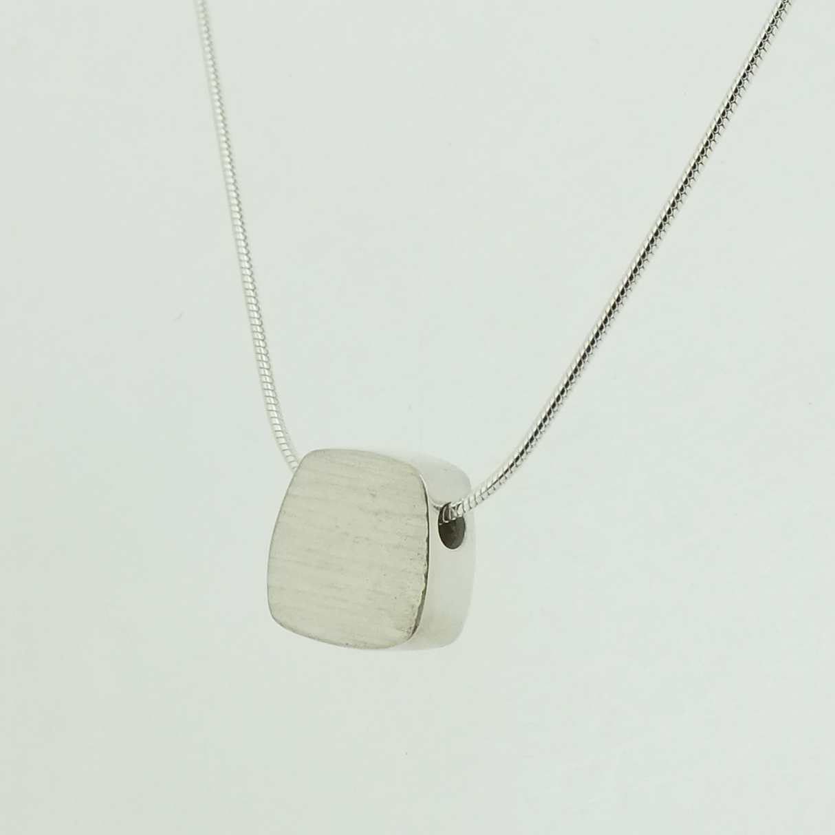 Fower Neukit Box pendant in textured sterling silver