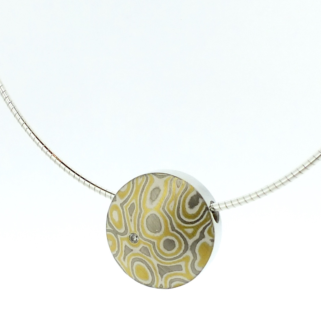 22k gold, 18k white gold and silver mokume gane small discus pendant with diamond detail