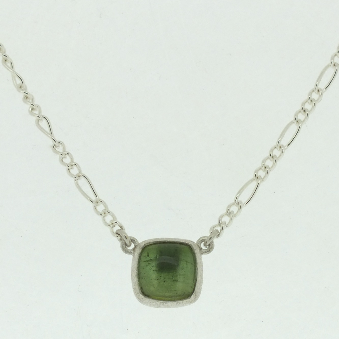 Green Tourmaline Cushion Cabochon Pendant in frosted sterling silver