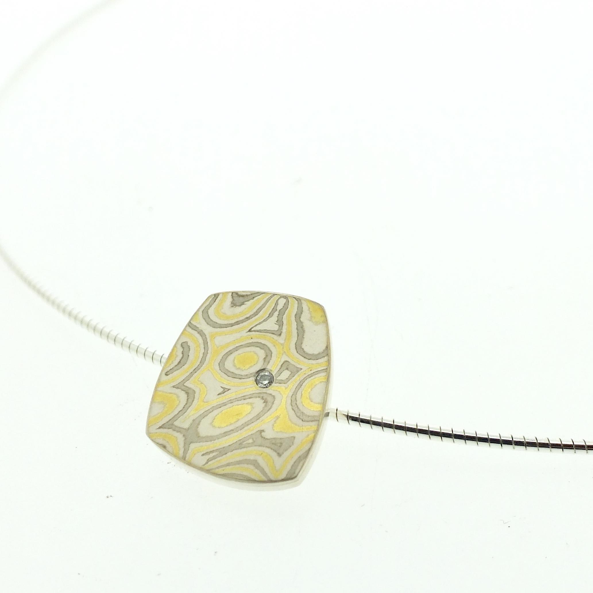 22k gold, 18k white gold and silver mokume gane small Fower Neukit pendant with diamond detail