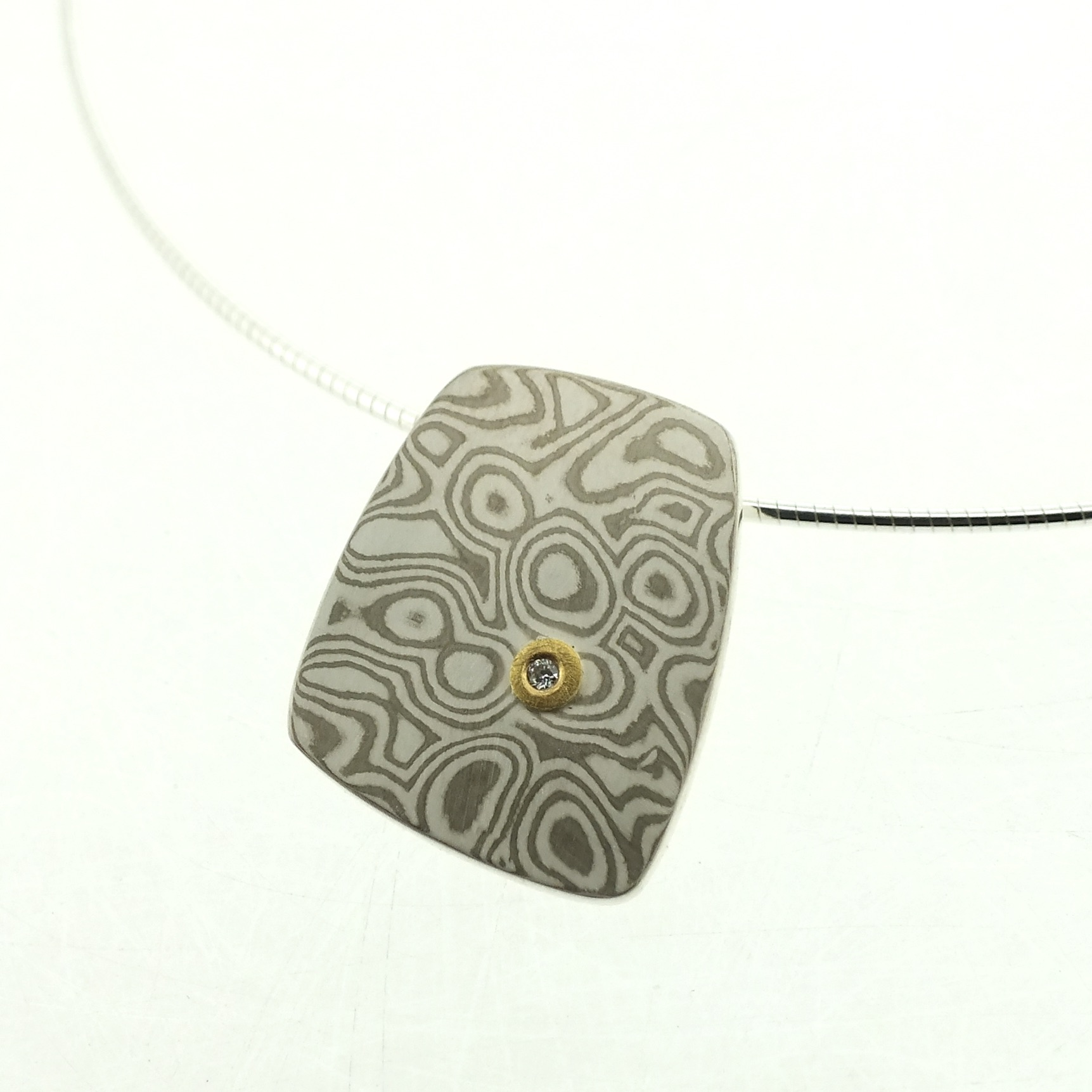 18k white gold and silver mokume gane large Fower Neukit pendant with 22k gold and diamond detail