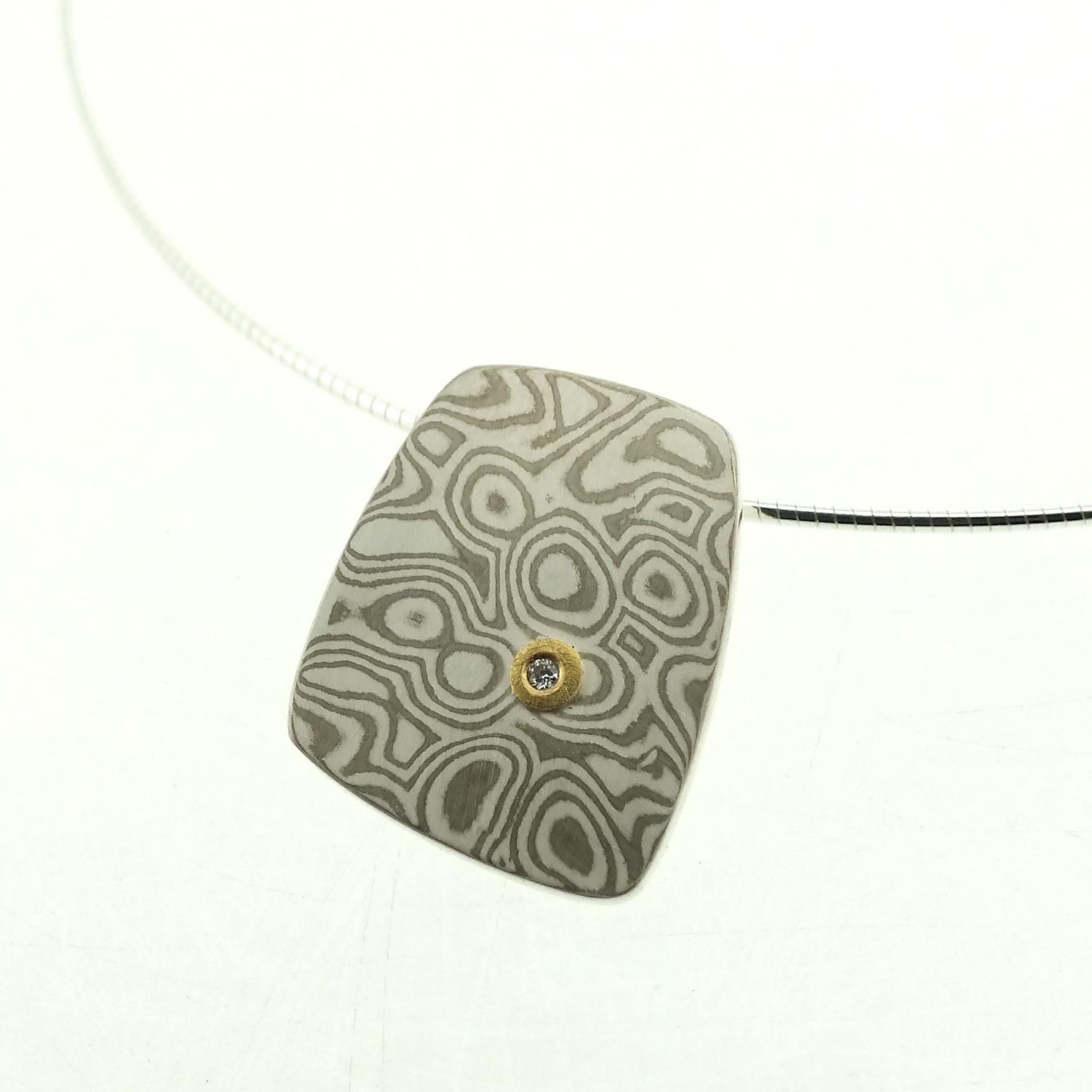 18k white gold and silver mokume gane large Fower Neukit pendant with 22k gold and diamond detail