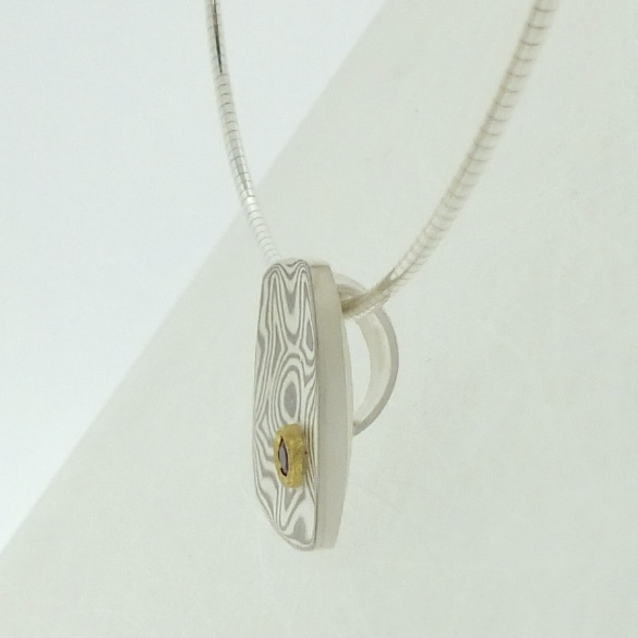 18k white gold and silver mokume gane small Fower Neukit pendant with ruby in 22k gold setting