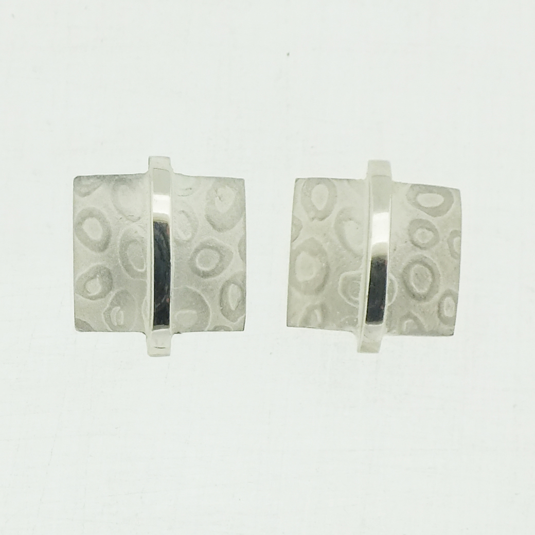 Small square textured silver stud earrings with polished bar