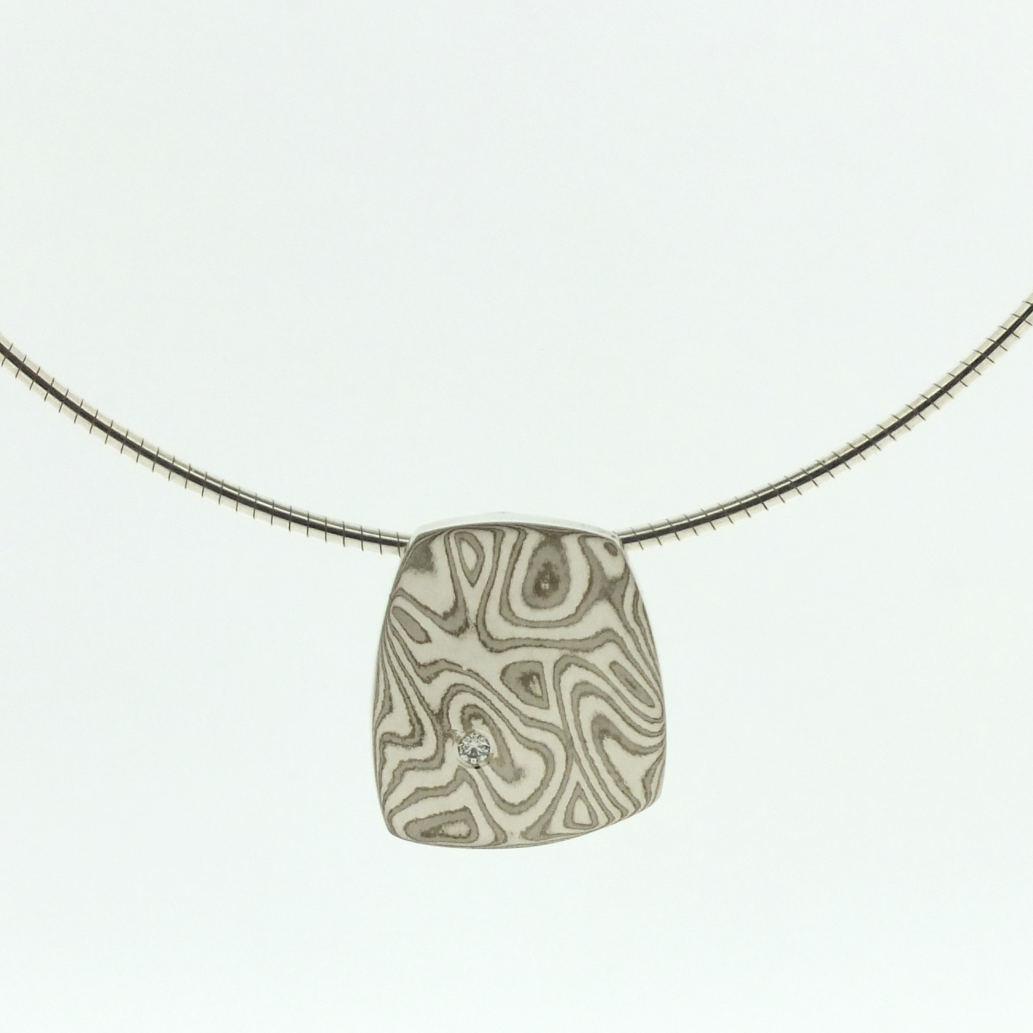 18k white gold and silver mokume gane small Fower Neukit pendant with diamond detail