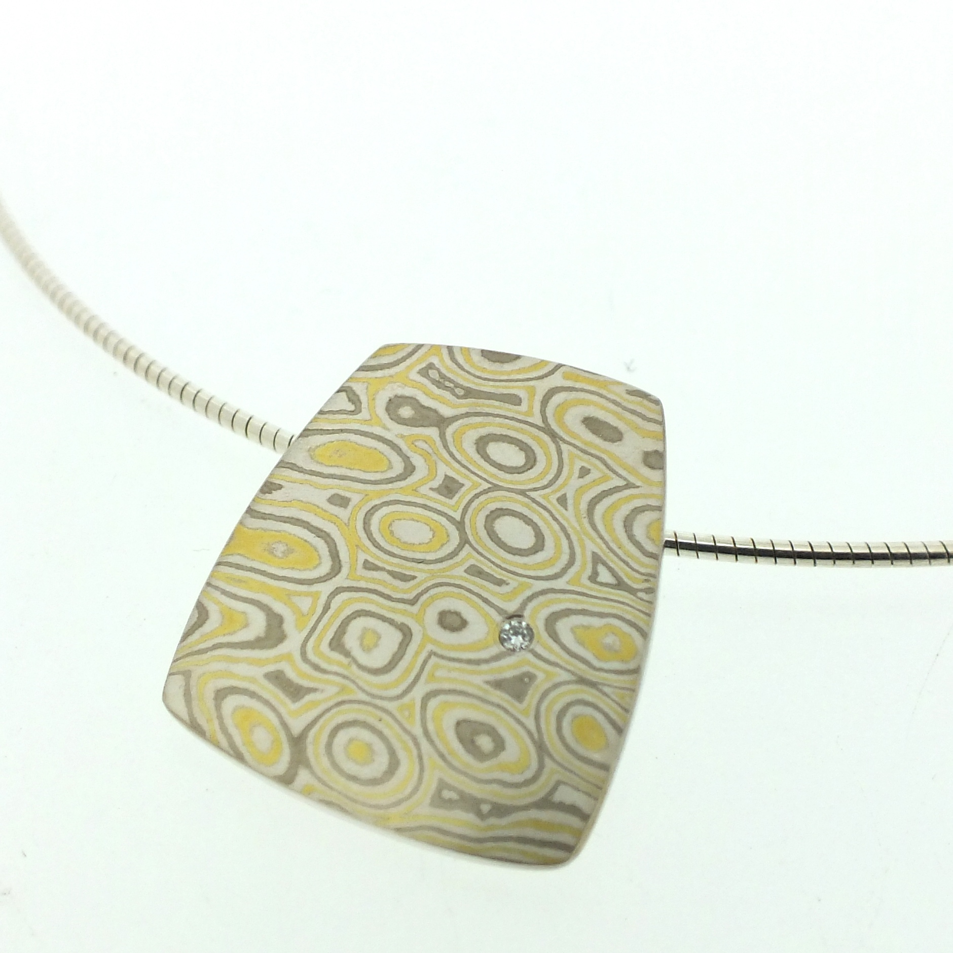 22k gold, 18k white gold and silver mokume gane large Fower Neukit pendant with diamond detail