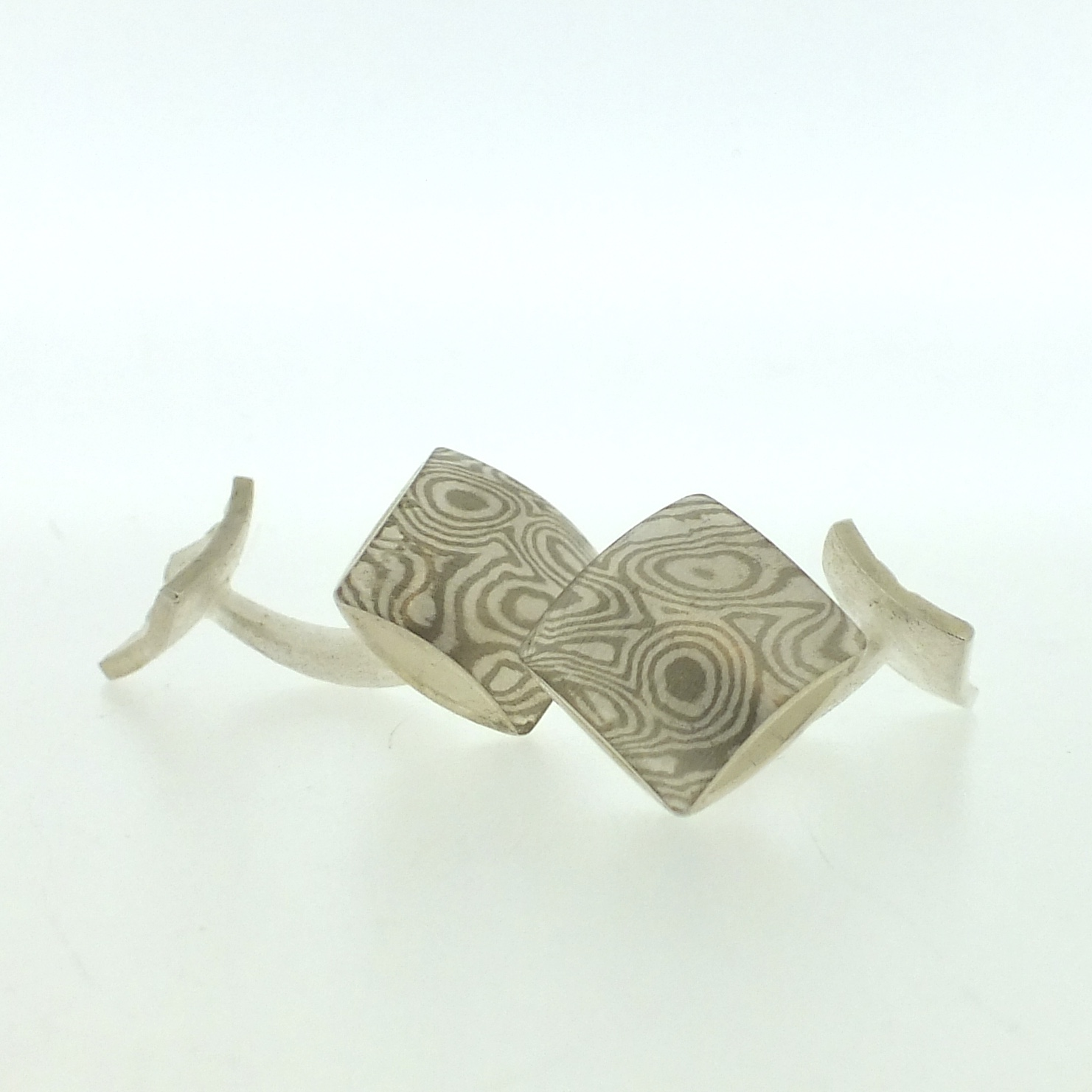 18k white gold and silver mokume gane square pillow cufflinks