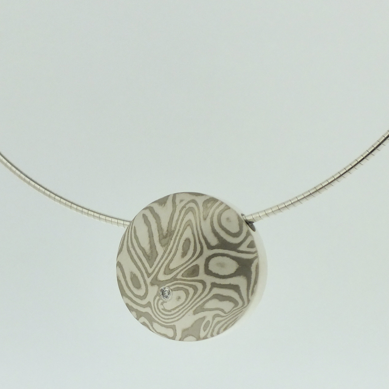 18k white gold and silver mokume gane medium Discus pendant with diamond