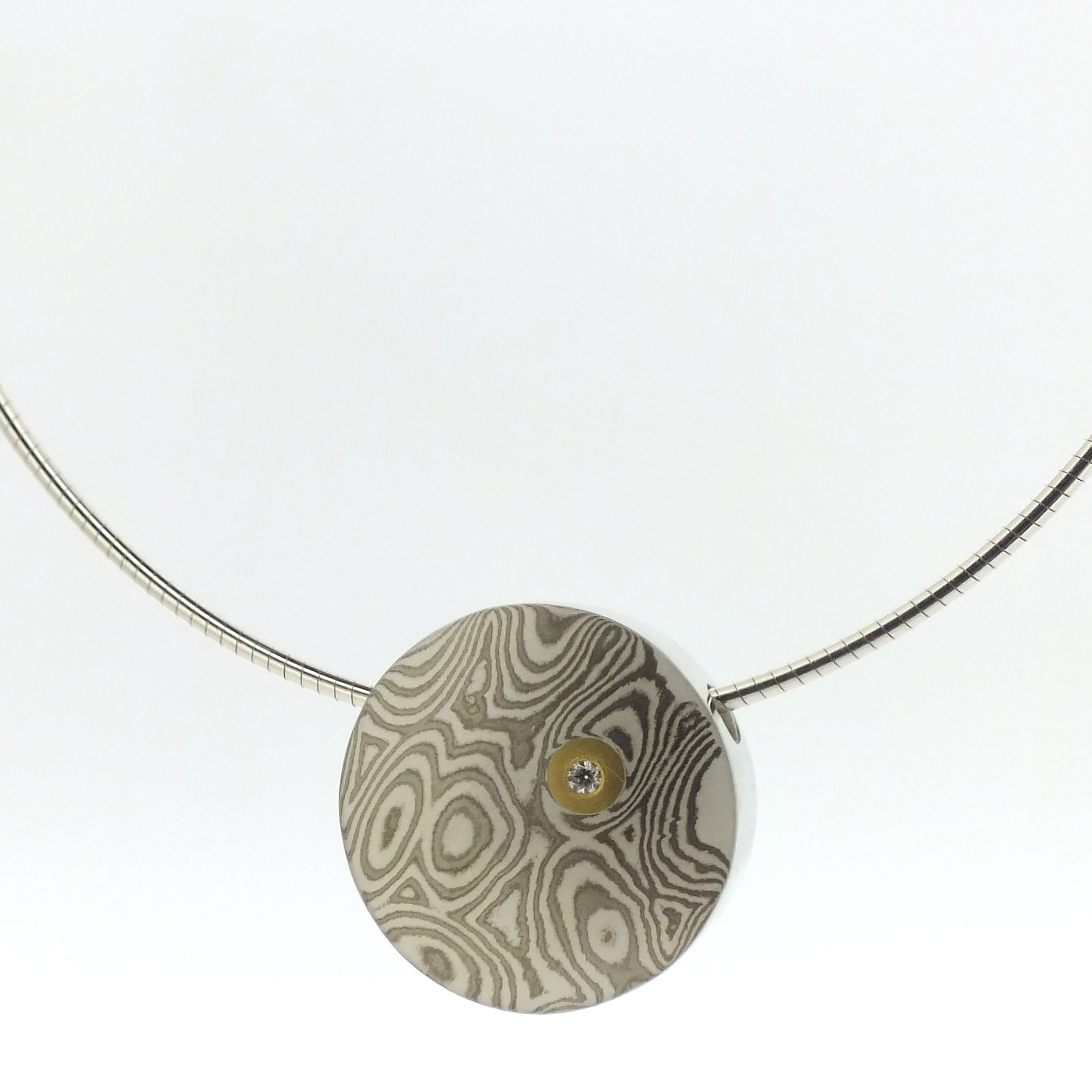 18k white gold and silver mokume gane small discus pendant with 22k gold and diamond detail