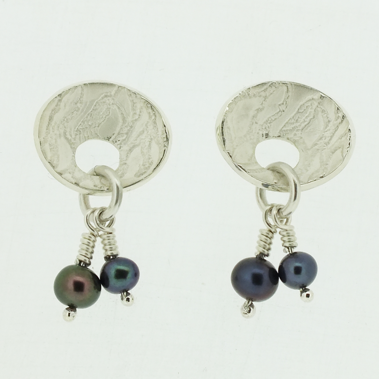 Concave oval textured silver stud earrings with black pearl drop