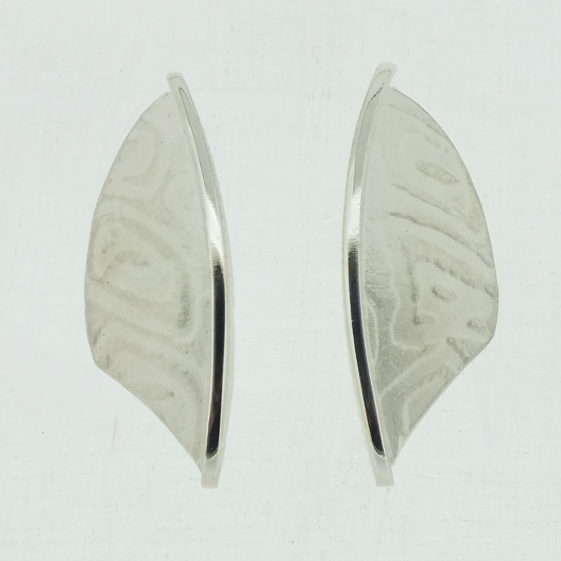 Small Leaf textured silver stud earrings with polished bar