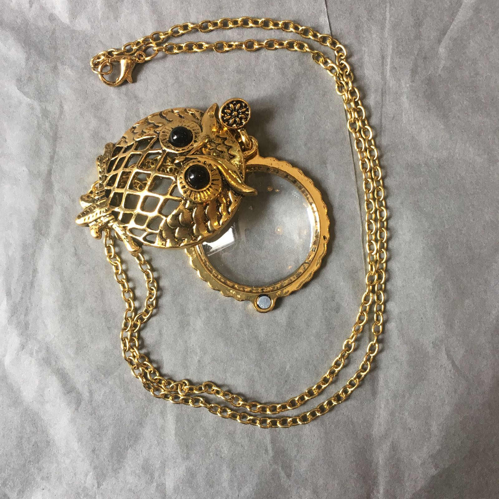 Magnifier With Cover in Gold Tone Metal on Chain.