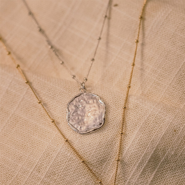 SILVER TEXTURED DISK NECKLACE