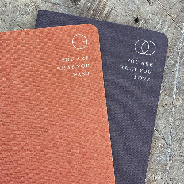 "LINEN COVERED MEMO NOTEBOOK ""YOU ARE WHAT YOU..."" {was £8}"
