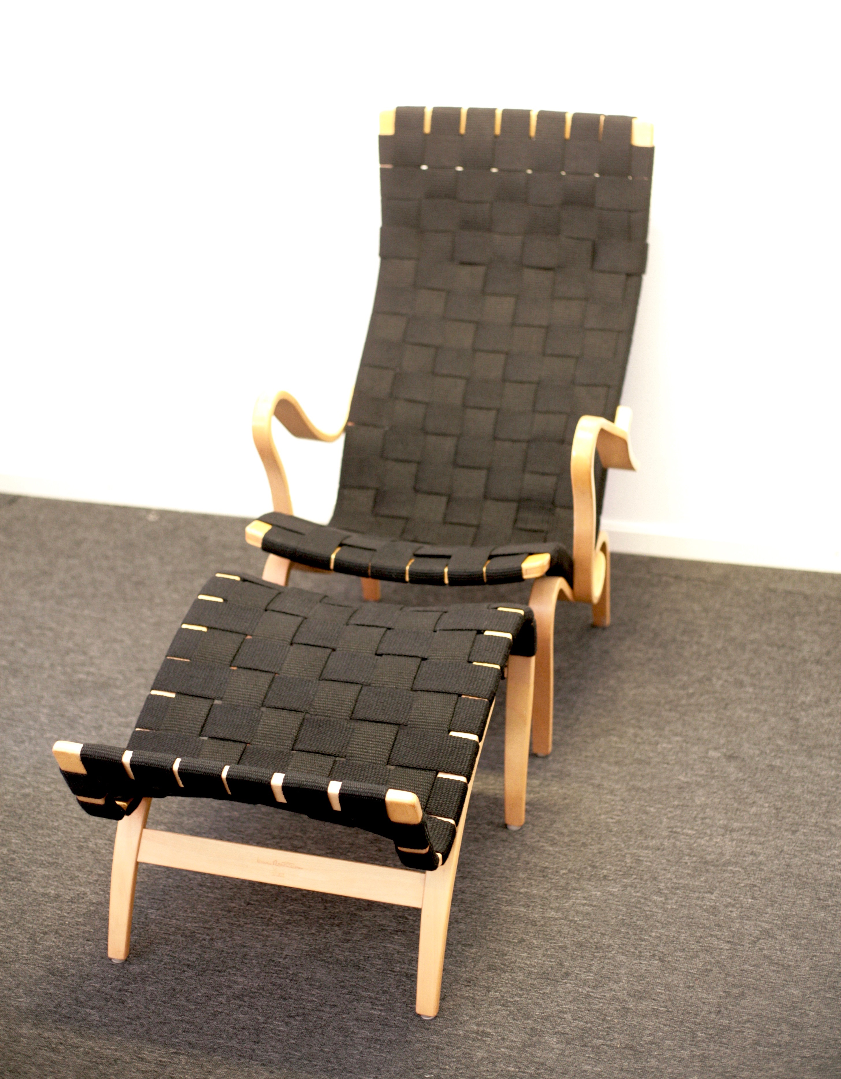 Easy chair Pernilla 2 with foot stool by Bruno Mathsson