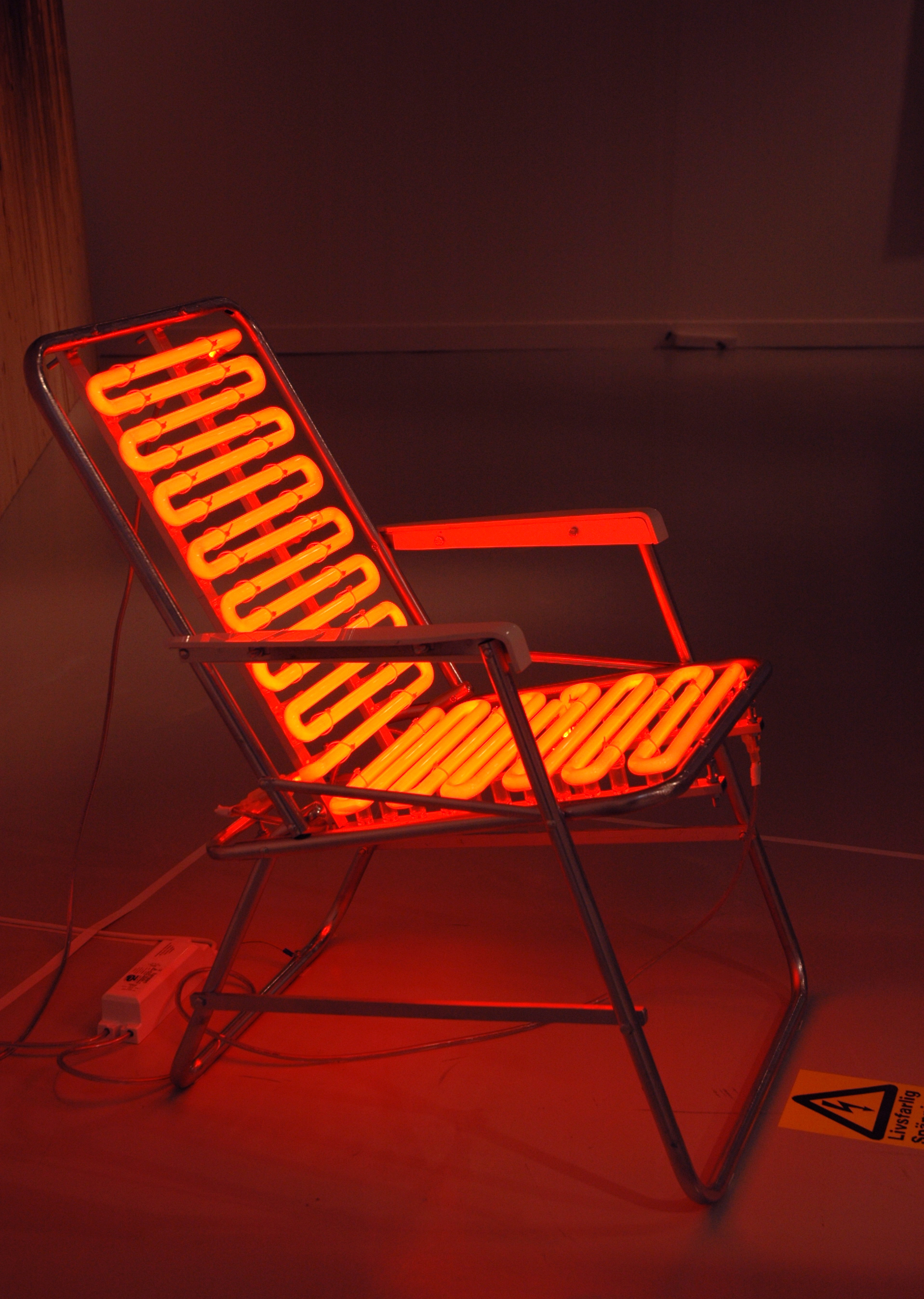 Joakim Allgulander - Burned, installation, neon and sun chair