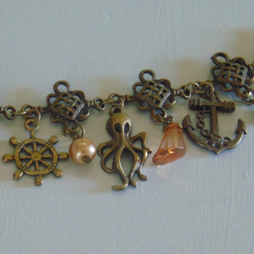 Bracelet - Brass Effect Nautical Charms with Amber Beads