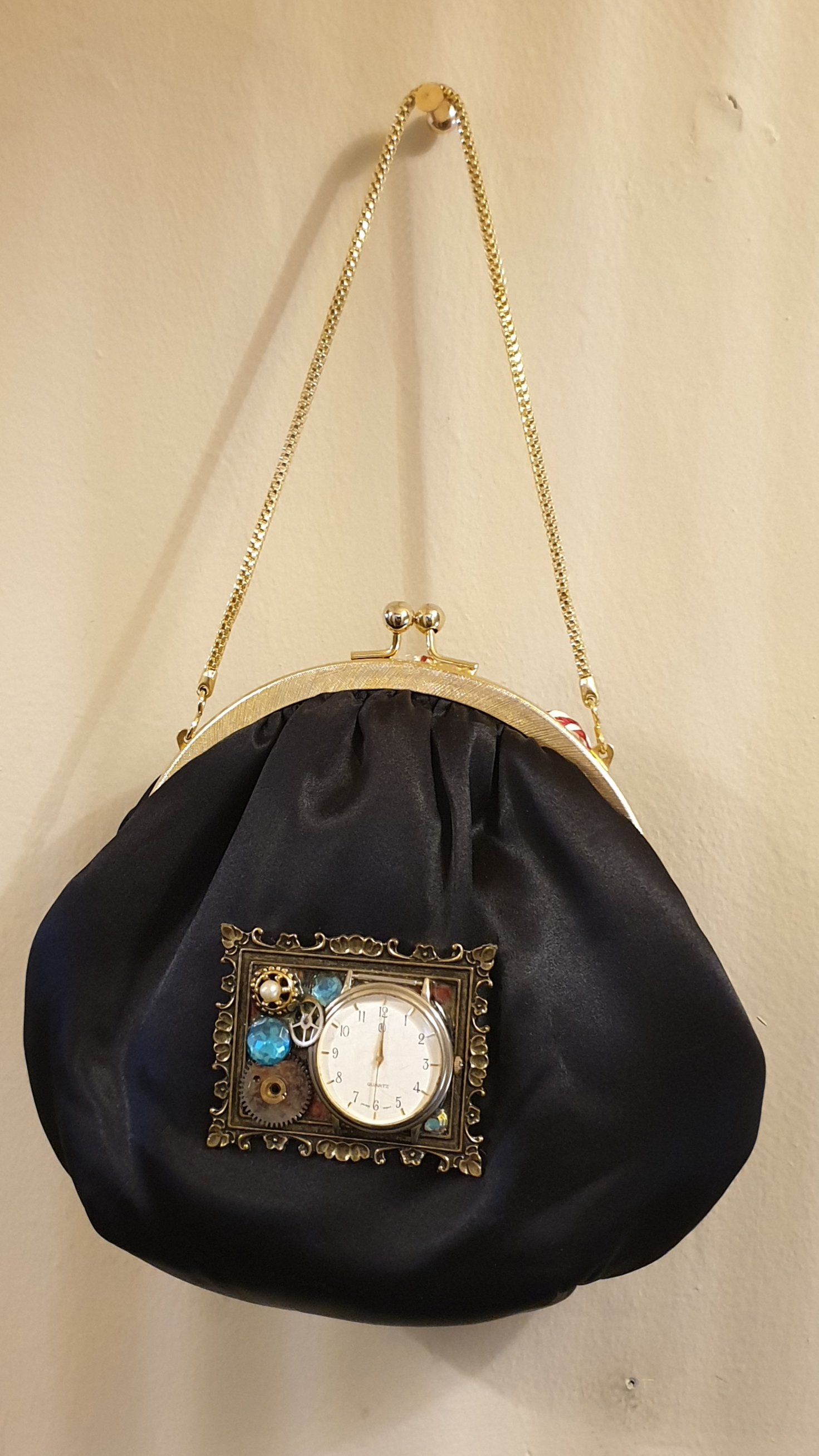 Black satin wrist bag