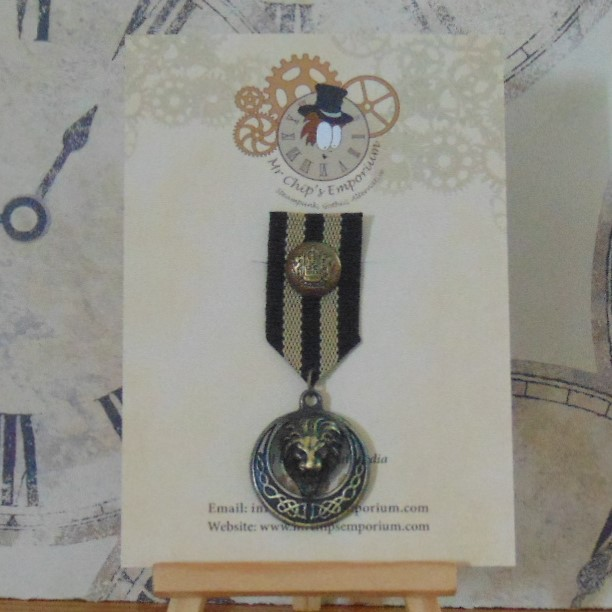 Medal #7 - Lion head, black/beige ribbon