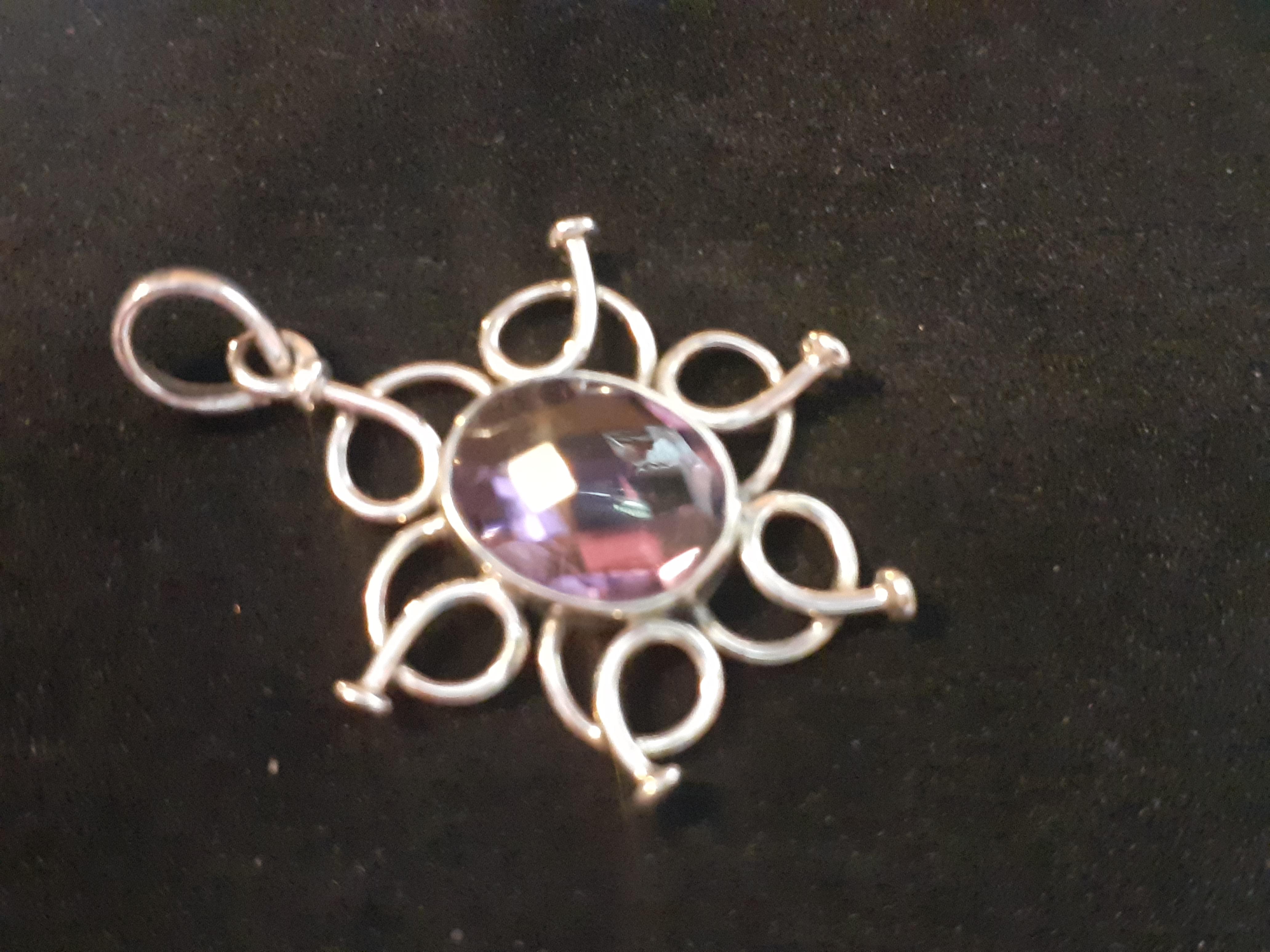 Amethyst faceted flower pendant