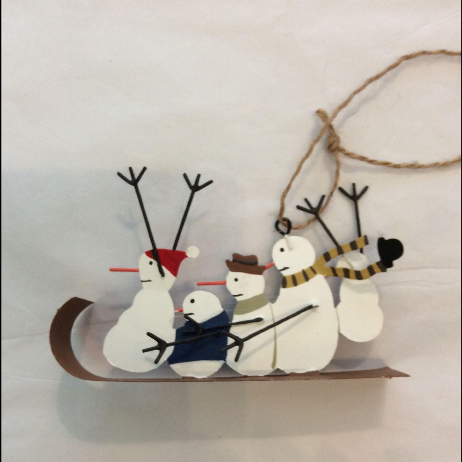 Snowmen on sledge