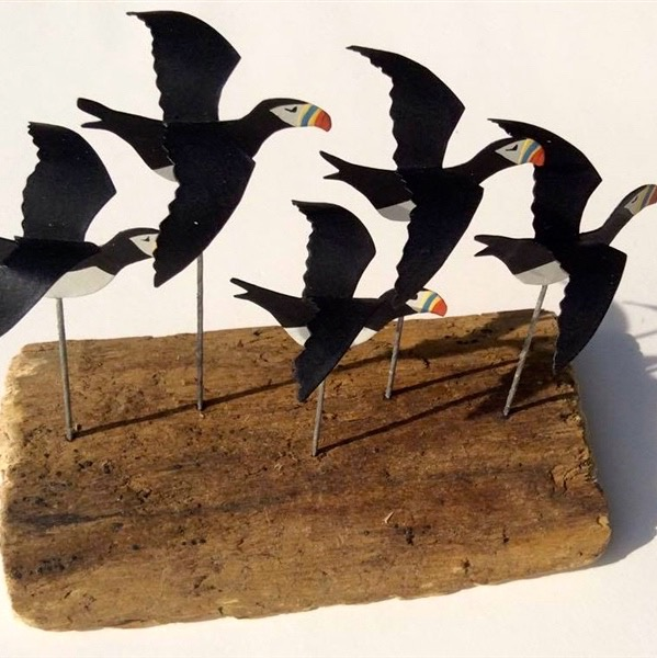 Flying Puffins on Driftwood