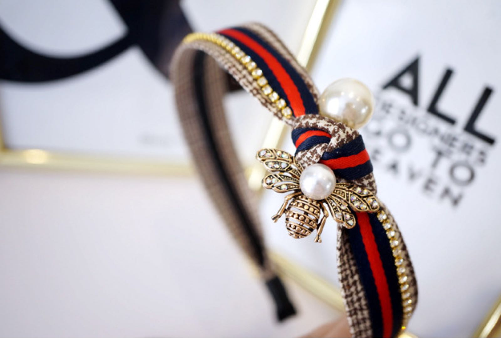 Designer inspired headband with crystal and Pearl detail and navy and red check ribbon